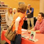 Special Education teacher Brad Smith signs copies of his book
