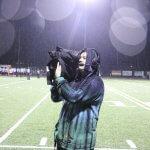 BGHS Junior Benjamin Cahoon operates a camera at a football game