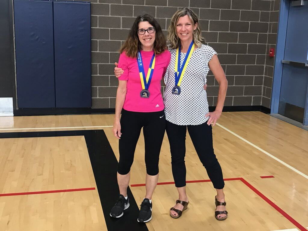 Sandee Myers and Krista Roadifer with their marathon medals
