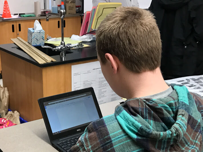 Seventh grade student using a Chromebook