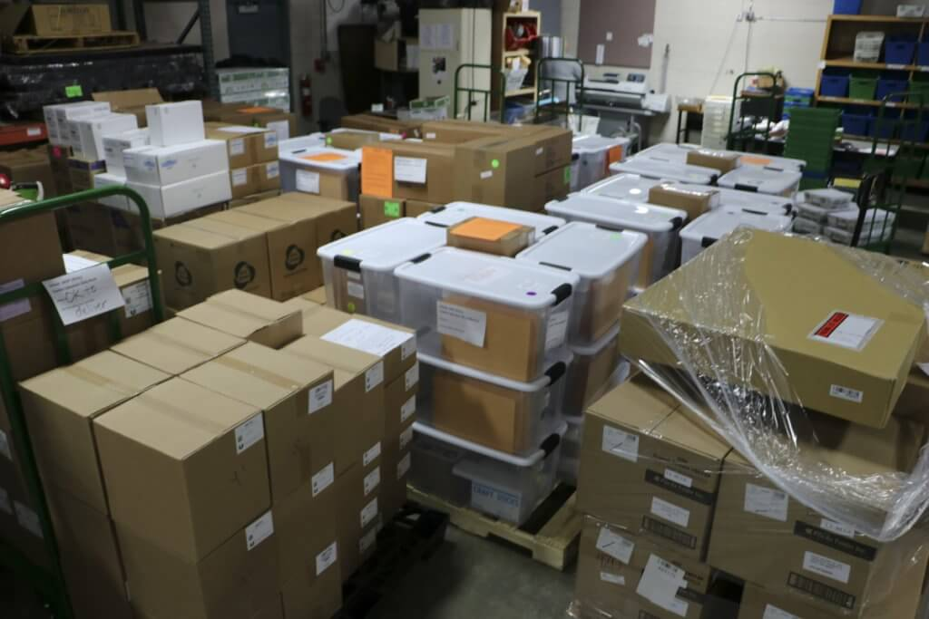 Boxes full of new curriculum materials in the warehouse