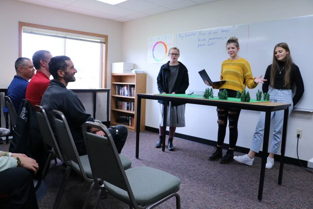 RHL students present to a panel of experts