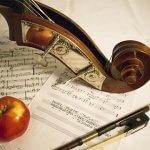 An apple on sheet music