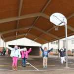 Kindergartners at Maple Grove at recess under the covered play structure
