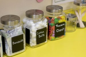 Bandaids, cotton balls, treasure chest